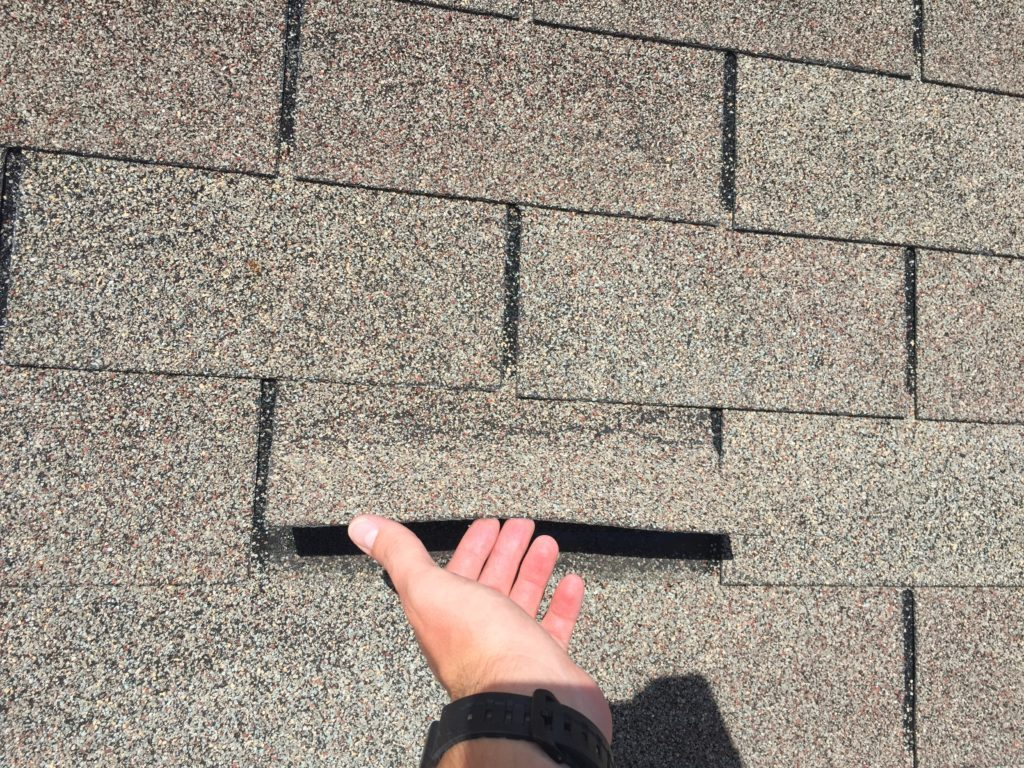 Creased Shingle from wind damage Tampa Florida